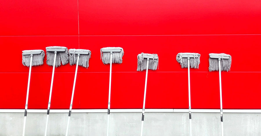 mops left on red wall
