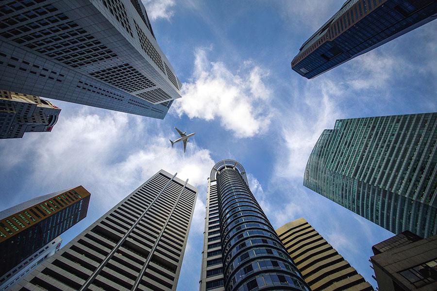 skyscraper and plane